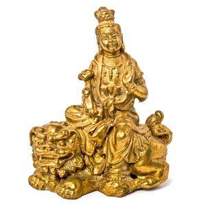 Femme Bouddha assise sur un chien dragon